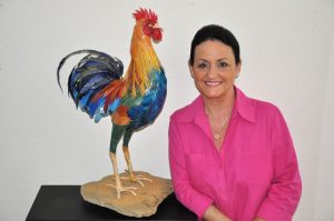Tania Begg with her paper and tape rooster sculpture