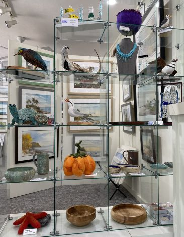 glass shelves with fiber art and wood sculpture