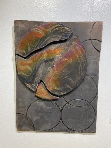 Sue Housler piece antitled war of worlds tile on wall